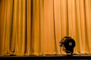 Photo of spotlight on a stage curtain