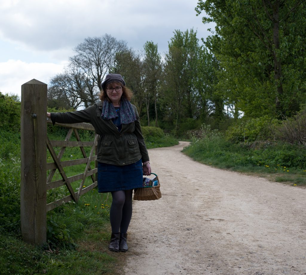 photo of debbie at the start of a long footpath