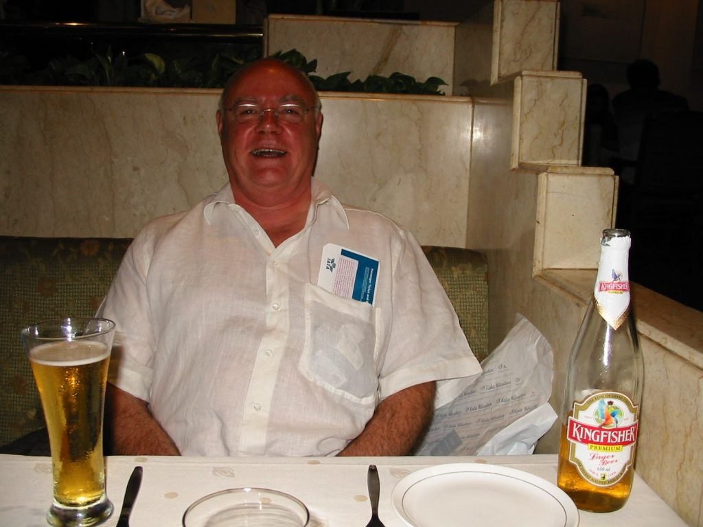 photo of John in a restaurant with a ticket sticking out of his shirt pocket