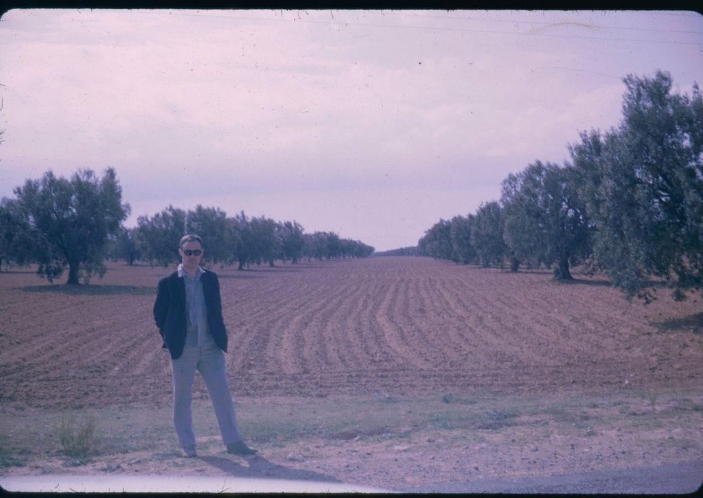 Photo of John in a field in North Africa