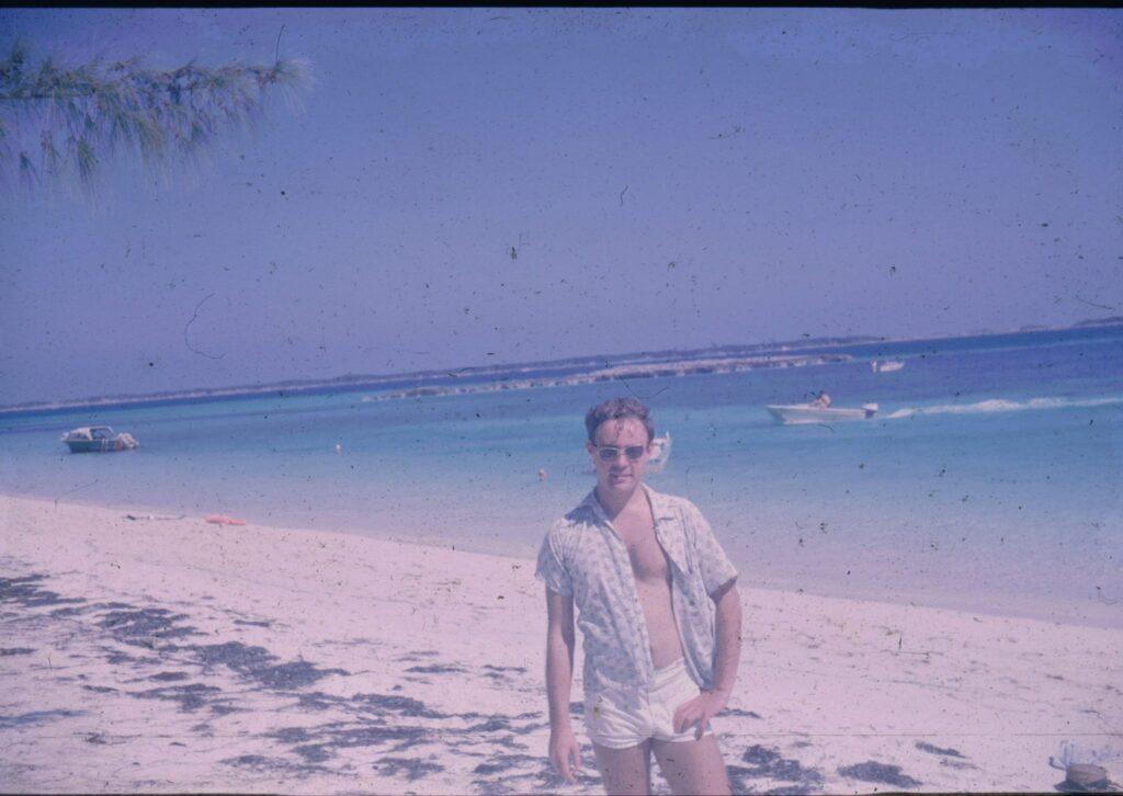 Photo fo John Lynch on the beach in the Bahamas 1966