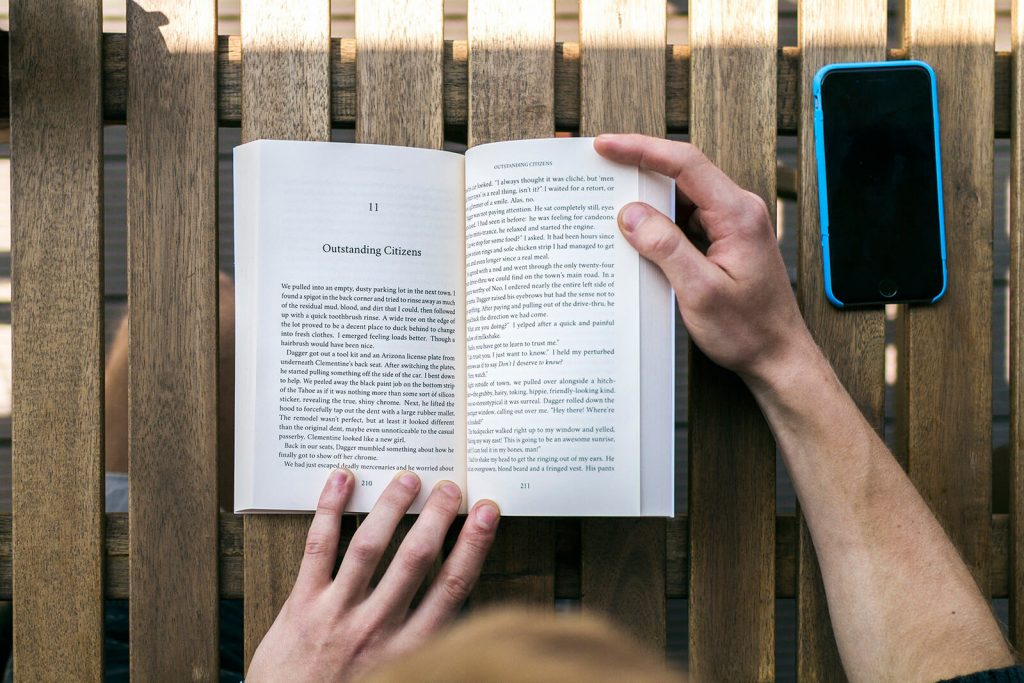 photo of holding a book open