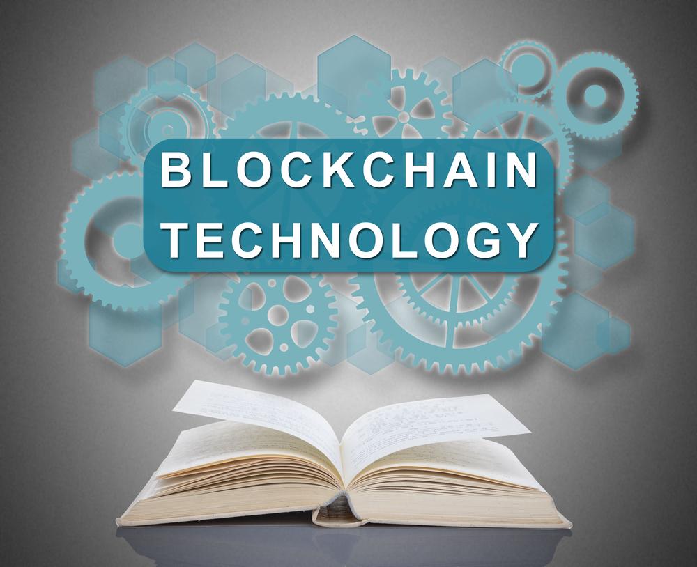 Blockchain technology concept above an open book