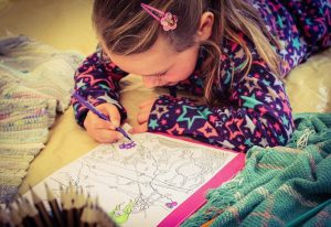 Photo of girl colouring