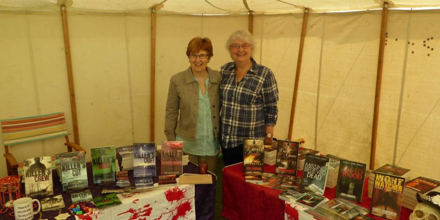 Photo of two authors with their stalls