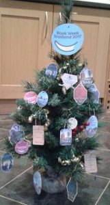 photo of Christmas tree decked with miniature book labels