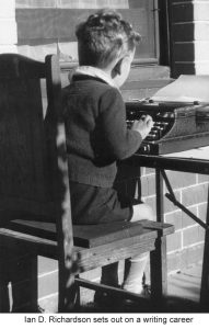 image of small boy at typewriter