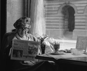 image of old lady reading a newspaper in a vintage photo