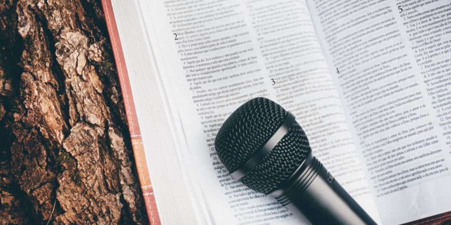 Photo Of A Microphone On A Book