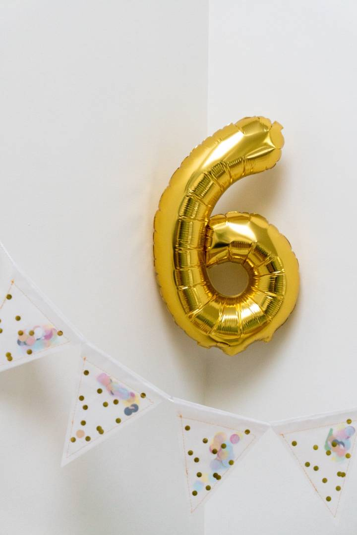 Photo Of Balloon Shaped Like A Number 6 With Bunting