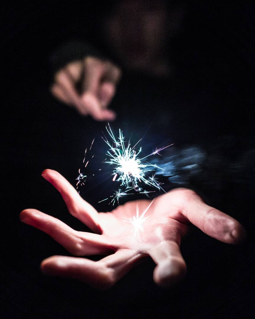 Picture Of Sparkler With Sparks In Palm Of Hand