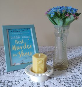 cover of book in frame with flowers and candle