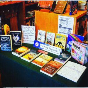 Tabletop display of DartFrog books