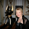 Photo of Leena Pekkalainen with ancient Egyptian artefacts