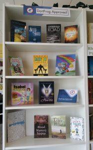 bookshelf full of Dartfrog books