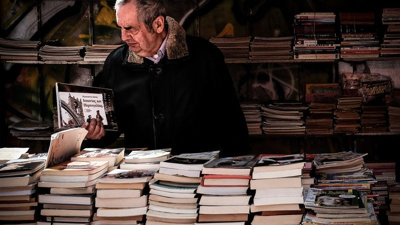 Old Man Browsing Bookstall