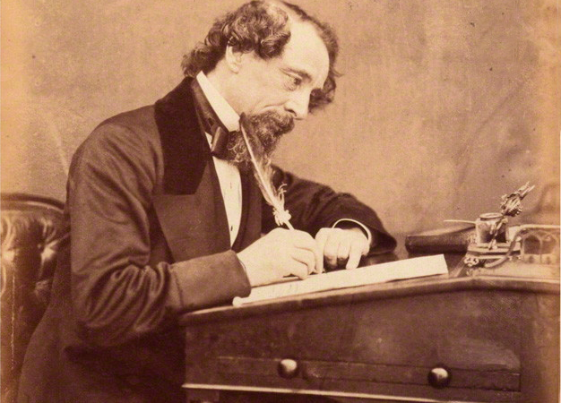 Photo Of Charles Dickens At A Writing Desk