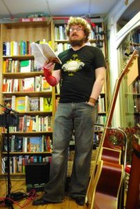 photo of Dan in his author uniform red lace glove