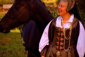 photo of Emily Cotton in medieval dress with horse