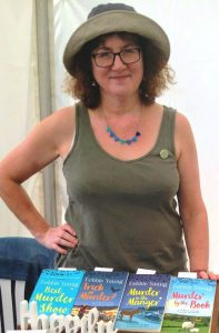 Photo of Debbie Young in sunhat that is her summer author uniform