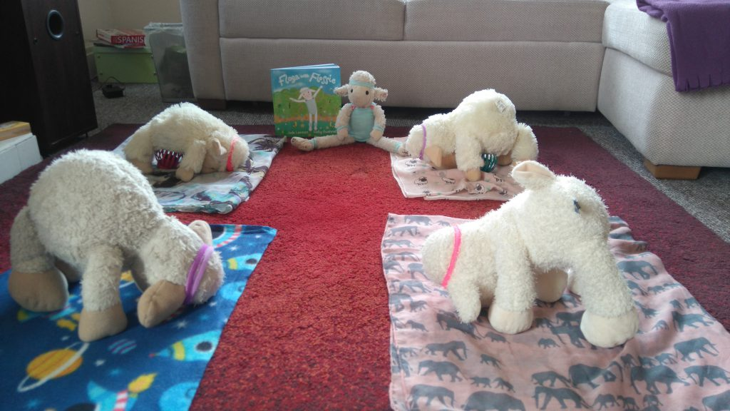 Yoga awareness day photo of toys doing yoga