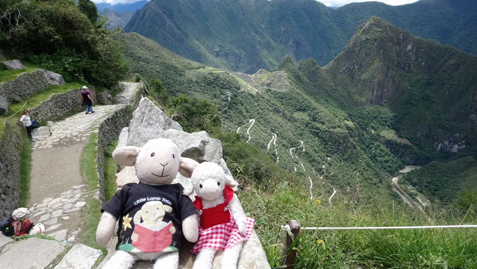 photo of two toys in dramatic Machu Picchu setting