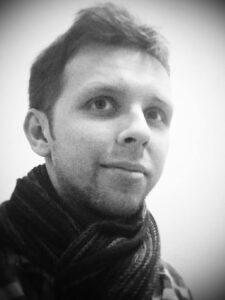 headshot of Adam Nicholls