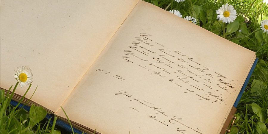 Photo Of Handwritten Poetry Journal On Grass
