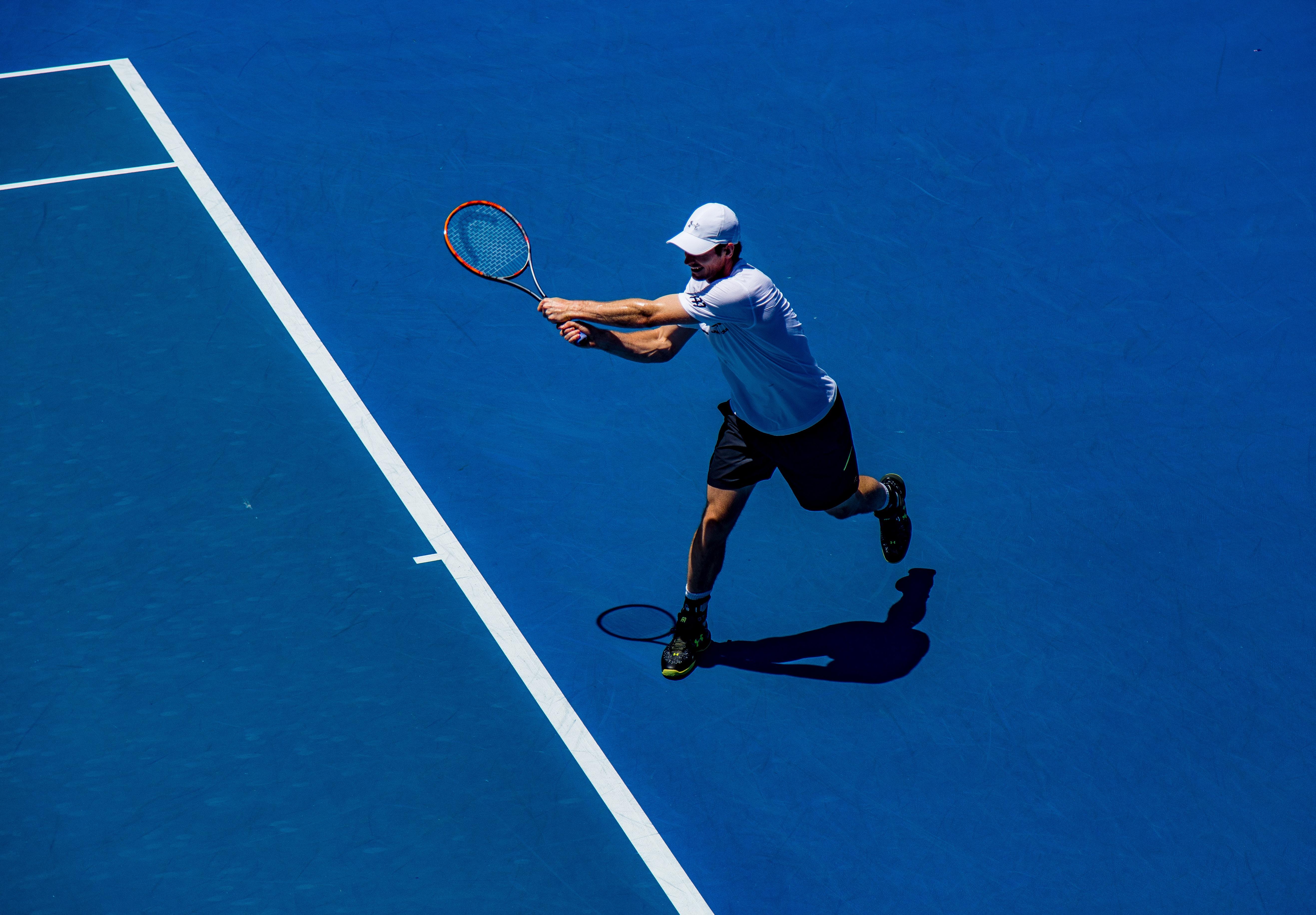 Photo Of Tennis Player By Christopher Burns Via Unsplash.com