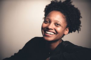 Headshot of Tracy K Smith, proponent of writing poetry for healing