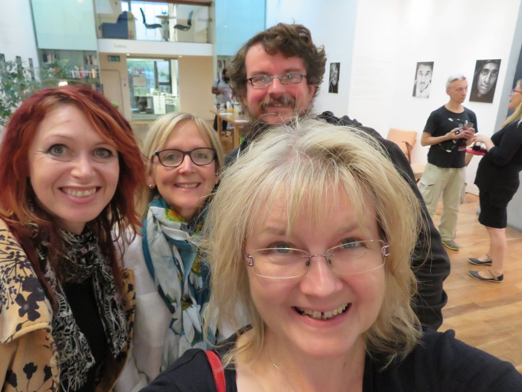 selfie of four authors at What Makes a Writer event