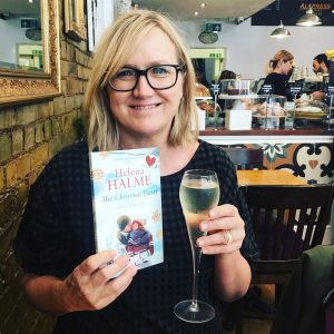photo of Helena Halme with wine and book