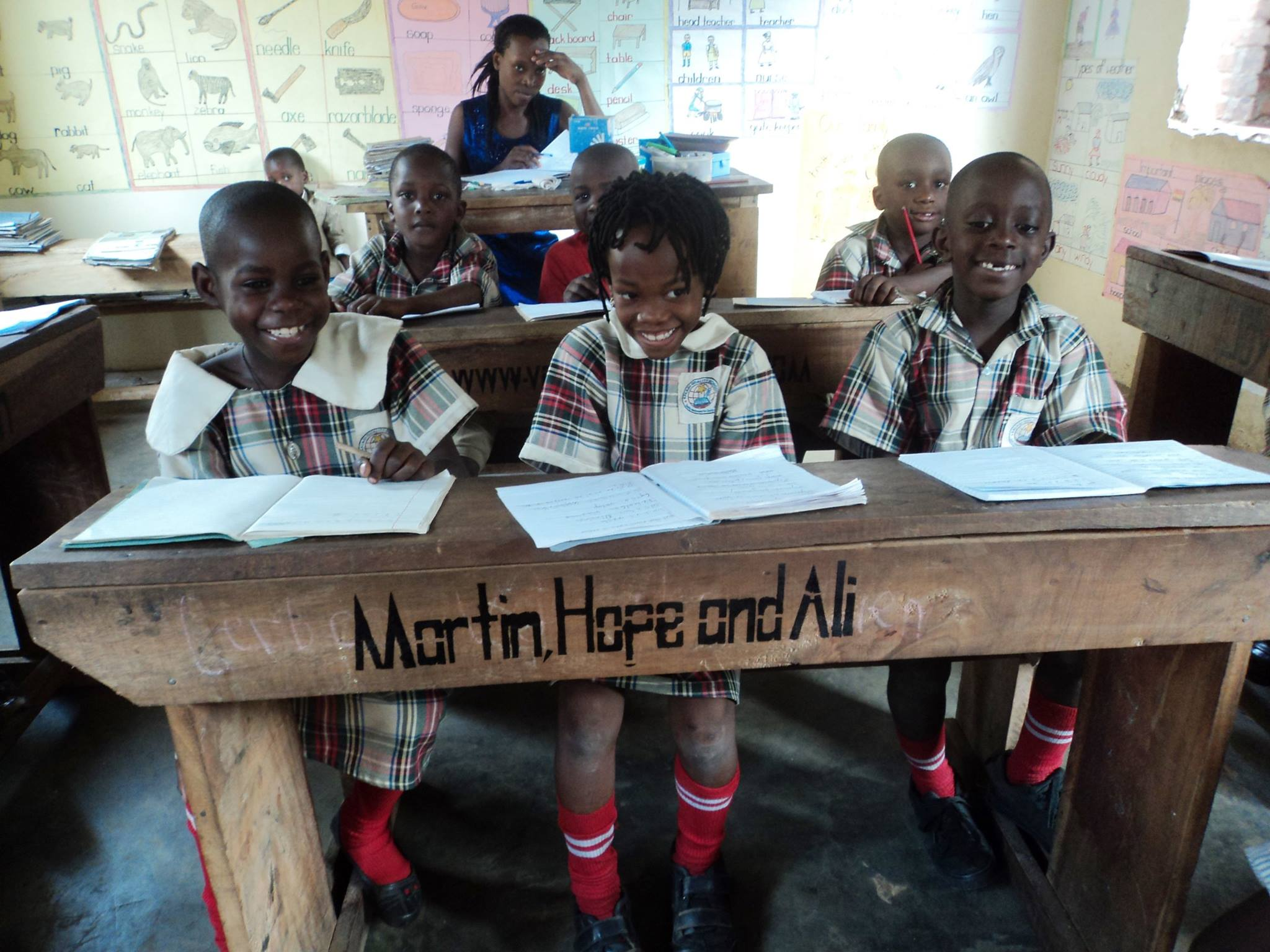 Image Of School Desk In Uganda With Author Names On It