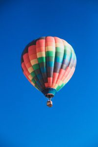 photo of a hot air ballon in flight