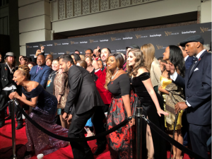 photo of lots of voice artists on the red carpet having fun