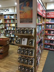 Photo of books on display in prominent aisle-end rack at WH Smith