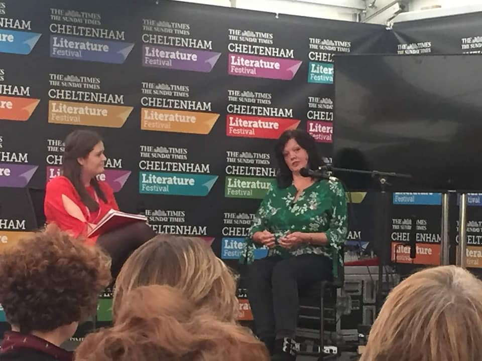 picture of Nicola Kelsall on stage at the Cheltenham Literature Festival