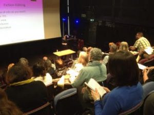 Image of busy self-publishing conference in action