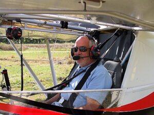 photo of Chris Calder in a microlight plane