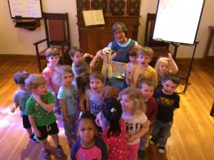 Photo of Cathy with lots of toddlers