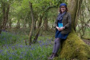 photo of Debbie Young in a bluebell wood